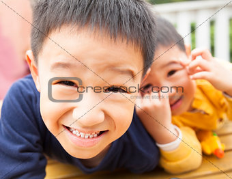 close up of two happy asian little boy
