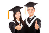  happy couple graduate students with thumbs up isolated on white