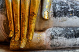 Beautiful golden hand of sitting Buddha in Wat Si Chum temple in