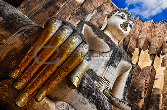 Sitting Buddha with golden hand in Wat Si Chum temple, Sukhothai