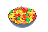 Colorful candy in a black bowl, isolated on white background