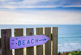 Beach sign path marker - pink and blue in Summer