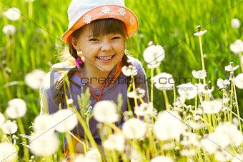 smiling girl in a field of dandelions