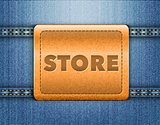 Store word on brown leather label on blue jeans background 