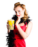 Glamorous woman holding popcorn
