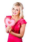 Woman holding a pink heart-shape