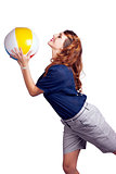 Woman Throwing Beach Ball On White Background