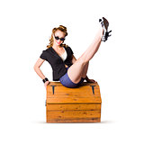 Pin-up seated on a pine trunk