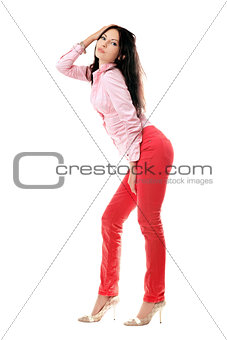 Playful young woman in red jeans
