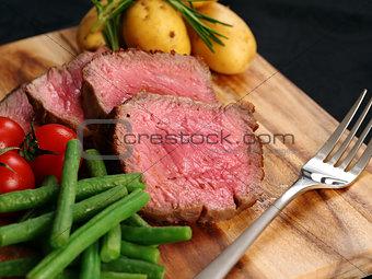 Sliced sirlion steak dinner