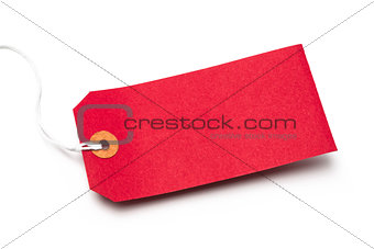Red cardboard or paper luggage tag isolated on white