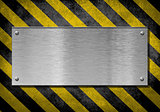 metal plate background with hazard stripes