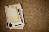 old photos bunch over burlap texture as a template for your pict