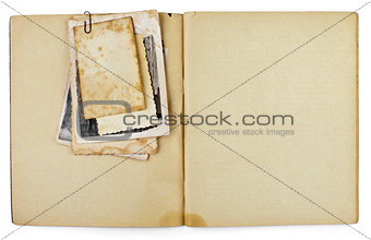 blank old opened diary or copybook with photos bunch isolated on
