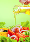 olive oil stream and healthy fresh vegetable salad