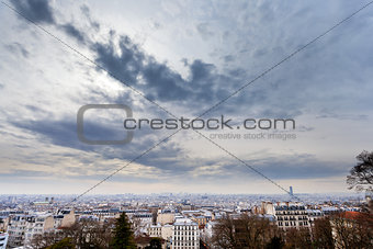 grey clouds under big city, Paris