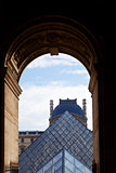 arch and glass pyramid of Louvre, Paris
