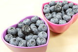 blueberries in violet bowls