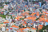 Little houses crammed in a big city in Asia