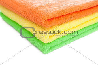 stack of fresh colorful towels isolated
