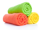 stack of fresh colorful towels rolls isolated