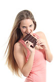 Beautiful woman eating a chocolate bar