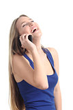 Happy woman laughing on the mobile phone