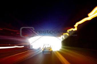 Car exiting a dark tunnel