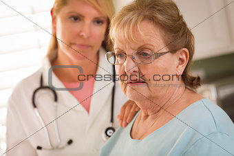 Senior Adult Woman Being Consoled by Female Doctor or Nurse