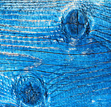 Old wooden board painted in blue. Background.