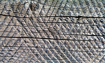 Old wooden board with traces of circular saw.  Background.