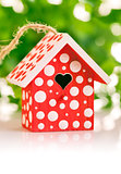 red birdhouse in white polka dot