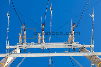 Electricity disconnector,insulators on a blue sky background