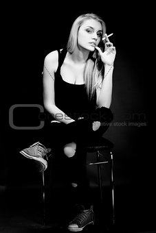Black and white portrait of smoking woman