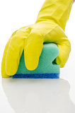 Gloved hand cleaning a white surface