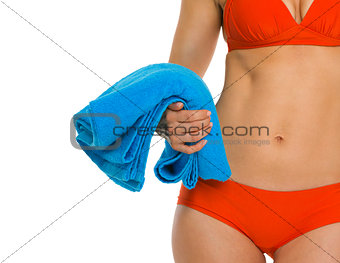 Closeup on towel in hand of young woman in swimsuit