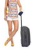 Closeup on young tourist woman with wheel bag