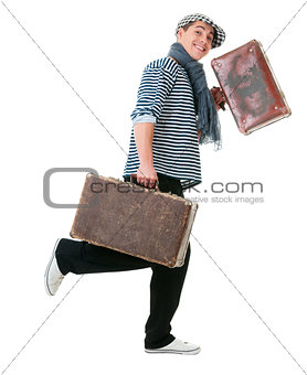 Happy running traveller with vintage suitcases