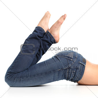 Close up of a beautiful woman legs with jeans and barefoot