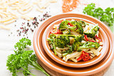 Pasta with roasted vegetables on a plate closeup