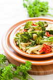 Pasta with pepper and broccoli closeup