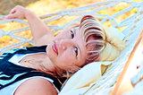Portrait of elderly woman resting in a hammock