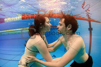 man and girl in swimming pool
