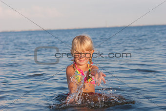 splashing in the water child