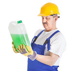 manual worker with green liquid over white