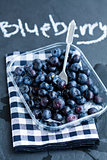 Fresh blueberries and fork