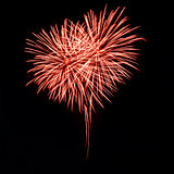 Bright red fireworks in the night sky in the form of heart