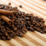 handful aromatic coffee beans with cinnamon