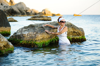 Beautiful woman splashing in the sea