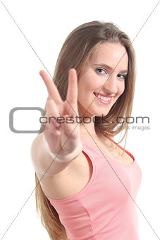 Young beautiful woman making the victory or peace gesture
